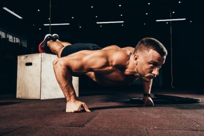 man doing elevated push ups