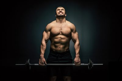 athlete gripping a heavy barbell