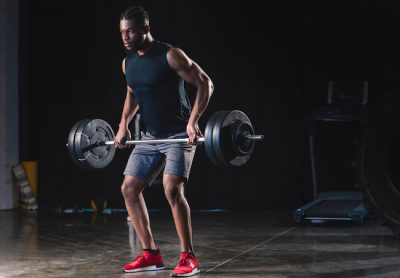 athletic man doing barbell exercises