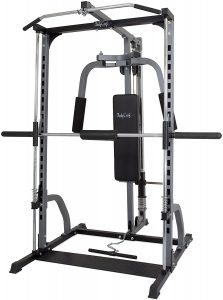 a strength training machine with barbell and pec deck stations