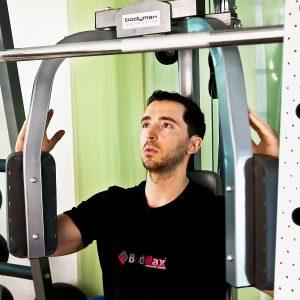 man performing a pec dec exercise