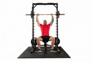 bodybuilder doing a shoulder press