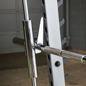 a barbell latching onto the rack with its safety hooks
