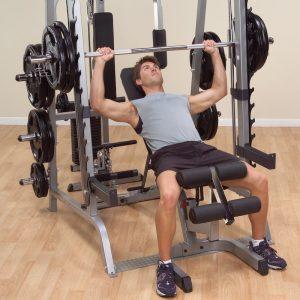 muscular man doing an incline press
