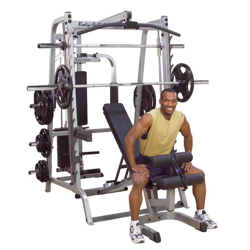 happy man sat on workout bench
