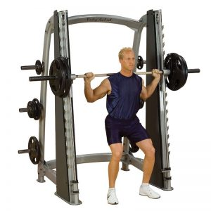man doing heavy squats
