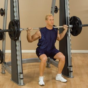 athletic man workout out his leg muscles inside