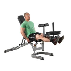 man doing seated leg extensions