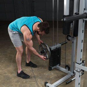 man loading weights onto a machine