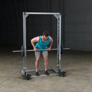 man rowing a barbell