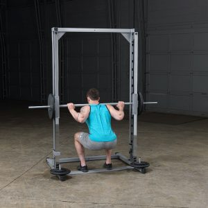 back view of man doing barbell squats