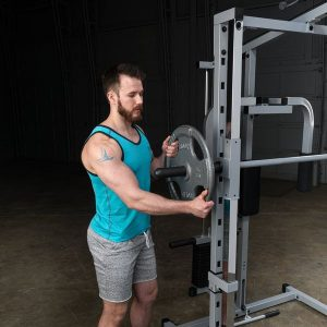man loading weight discs onto a barbell