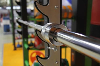 A barbell resting in a rack at the gym