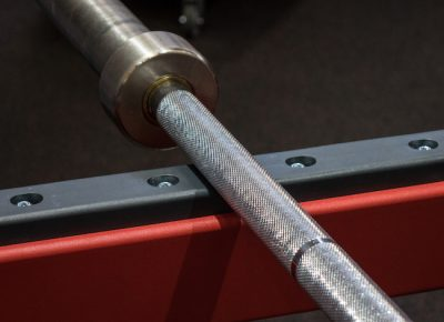 weight lifting bar on the rack in a fitness centre