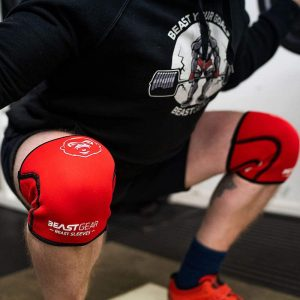 man doing squats in his beast gear knee sleeves