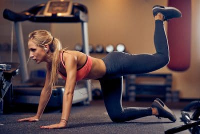 blonde woman performing glute exercise