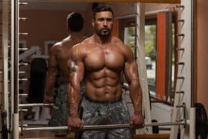 bodybuilder doing smith machine shrugs