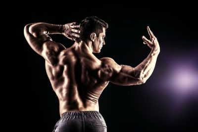 bodybuilder showing off his back and arm muscles