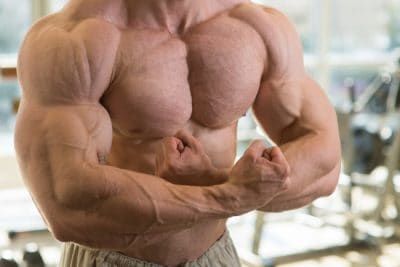 ripped bodybuilder flexing his upper body muscles