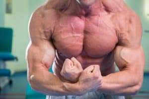 ripped bodybuilder flexing his huge muscles