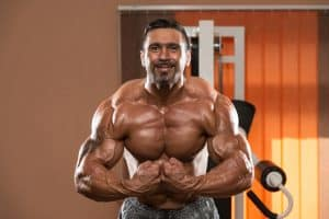 bodybuilder flexing upper body muscles