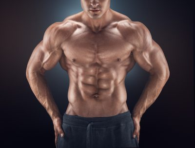 bodybuilder flexing his upper body