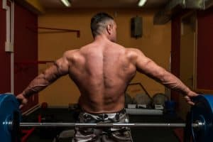 bodybuilder showing off his muscular back