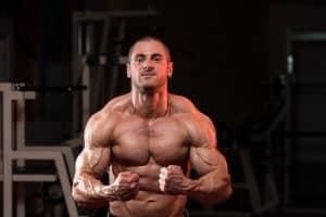 bodybuilder flexing his muscles