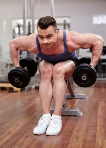 bodybuilder training his rear delts with dumbbells