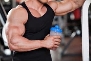 bodybuilder holding a protein shake