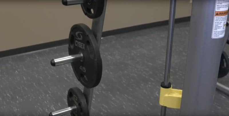 weight plates on some storage pegs