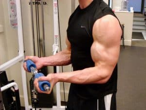 man doing cable curls with fat gripz