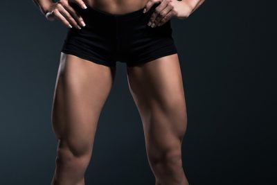 a close up of a female bodybuilder's quadriceps