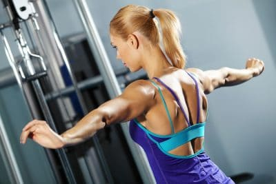 female training her shoulder muscles