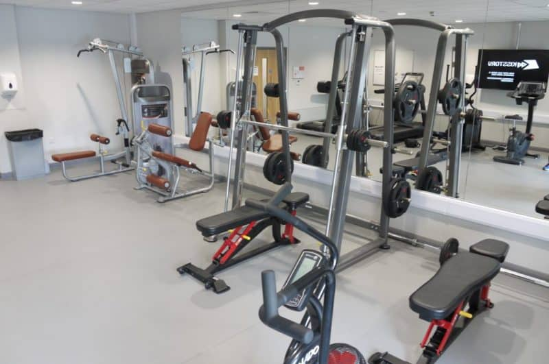 inside a gym with various machines