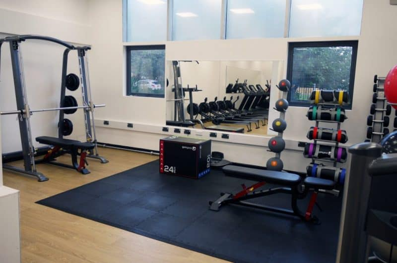interior of a school gym with various fitness equipment
