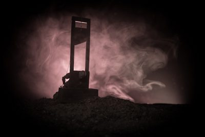 guillotine on a dark foggy background
