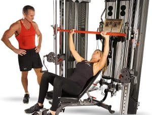 a man and a woman training chest