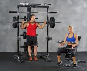 man and a woman performing weight training together
