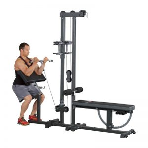 muscly man doing curls on a gym device for his biceps