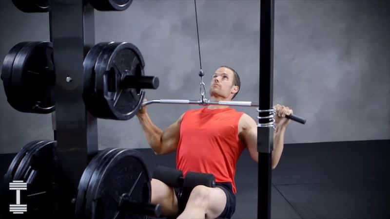 muscular man doing a lat pulldown