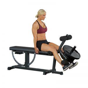 muscular woman doing leg extensions