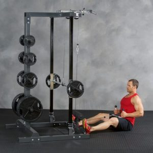 man in a vest performing low cable rows