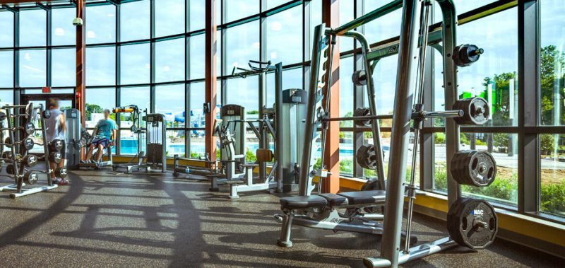 fitness equipment in a weight room of a gymnasium
