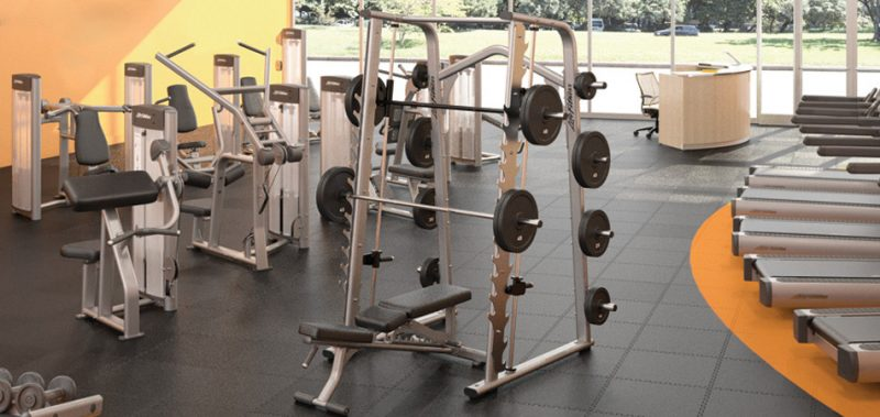 strength training equipment in the weight room of a fitness centre