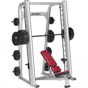 tall resistance training machine with weights on the bar