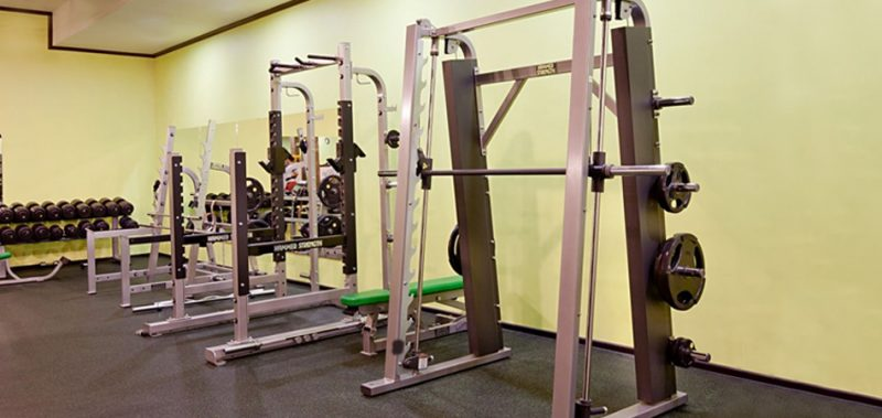 strength training machines positioned against a wall