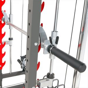 chrome barbell resting on the hooks of a gym rack