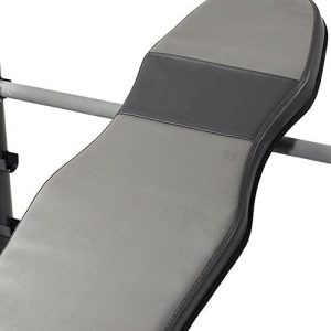 backrest of a weight bench resting on a metal bar