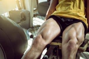 man doing leg extensions